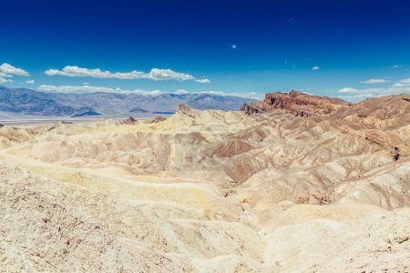 Photo for Panoramic view of mudstone and claystone badlands at Zabriskie Point. Death Valley National Park, California USA. - Royalty Free Image