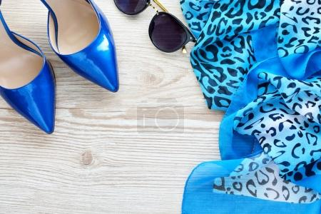 women's accessories: glasses, scarf and shoes. Concept of femininity and beauty