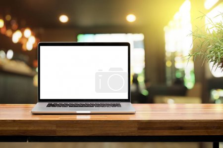 Photo for Laptop blank screen on wooden table in coffee shop morning sunshine background - Royalty Free Image