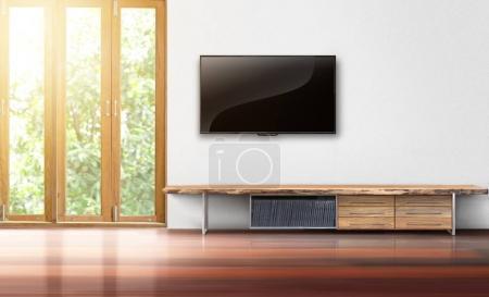 Photo pour TV sur l'intérieur vide salon mur blanc - image libre de droit