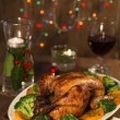 Roasted chicken  served on Christmas decorated tab...