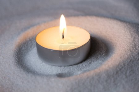 Candle on sand