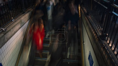 LONDON,UK, DECEMBER,The tube station at Oxford Circus is flooded every day with commuters on their way home after work, the station entrance struggles to cope with the volume of people. long exposure