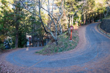Curve road to mountain of Chureito Temple. There are red lantern