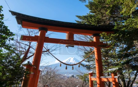 Red torii of Chureito temple with Mount Fuji as background. The gate and rope look like smile.