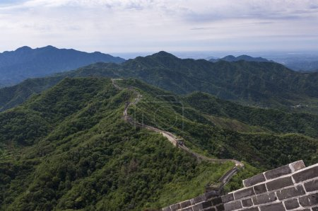 View of a section of the Great Wall of China and the surrounding mountains in Mutianyu