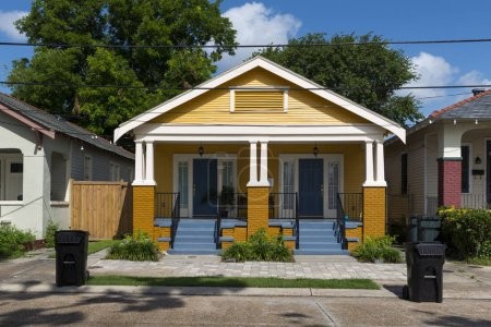 Photo for The facade of a traditional colorful house in the Marigny neighborhood in the city of New Orleans, Louisiana, USA - Royalty Free Image