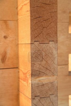Detail image of interlocking timber building.