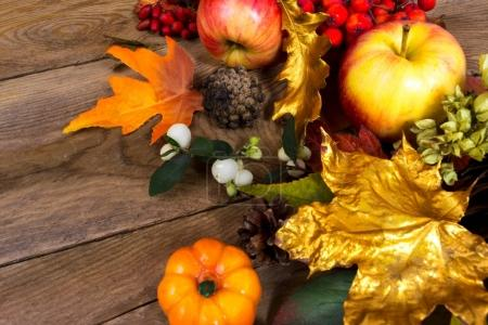 Thanksgiving background with golden and orange maple leaves