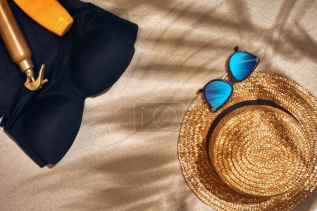 Photo for Summer background with straw hat, sunglasses, sunscreen bottle and flip flops. Top view. Still life. Copy space. flat lay - Royalty Free Image