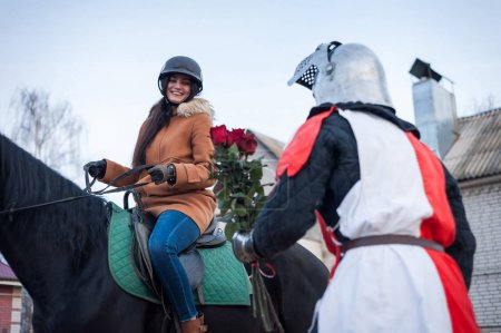 Photo for Medieval knight makes the offer of a lady on horsebac - Royalty Free Image