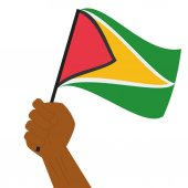 Hand holding and raising the national flag of Guyana