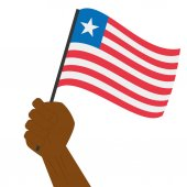 Hand holding and raising the national flag of Liberia