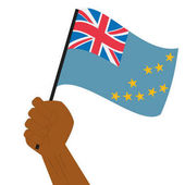 Hand holding and raising the national flag of Tuvalu