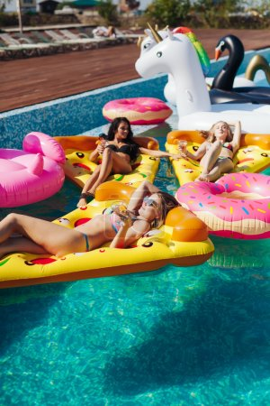 Photo for Sexy girls on summer party in the pool, have fun - Royalty Free Image