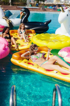 Sexy girls on summer party in the pool
