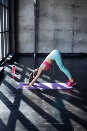 sporty woman practices yoga