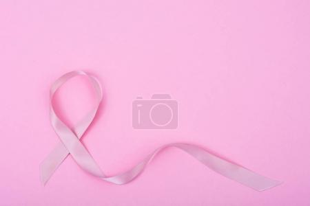 Healthcare, medicine concept. Pink breast cancer awareness ribbon and  help illness people