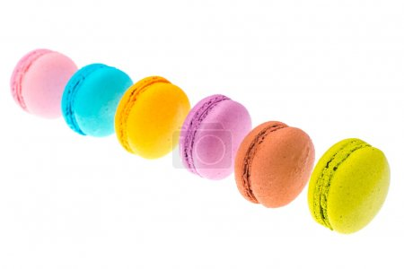 Delicate delightful delicious colored macaroons on white background