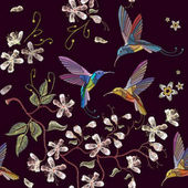 Humming bird and blossoming cherry embroidery seamless pattern