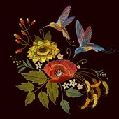 Two humming birds and sunflowers poppies ears of wheat