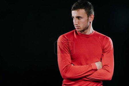 Photo for Portrait of handsome Caucasian sportsman wearing red sportswear and posing after exercises on dark background. Healthy inspirational fitness lifestyle, sport motivation. - Royalty Free Image