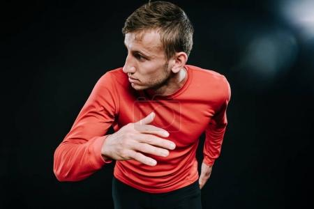 Photo for Athlete runner training at fast speed at gym. Close up shot of running man sprinting for success on run. Muscular fit sport model sprinter exercising sprint in red sportswear. Caucasian fitness model - Royalty Free Image