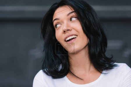 Photo for Close up portrait of positive human facial expressions and emotions. Isolated shot of attractive European woman looking and smiling broadly at one side during nice conversation with someone. Lifestyle - Royalty Free Image