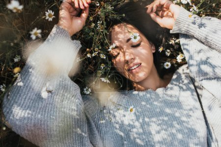 Photo for Close-up horizontal portrait of an attractive Caucasian woman smile and feel free and dream on meadow with copy space. Beautiful brunette young girl outdoors enjoying nature. Cover idea mood - Royalty Free Image