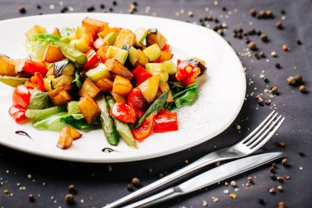 stir-fried vegetables on a white plate