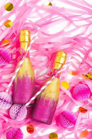 bottles with confetti and honeycomb balls