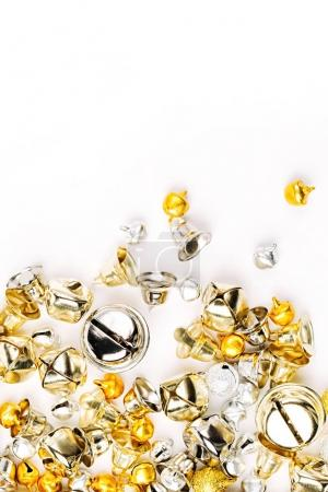 Gold and silver Jingle bells on white background, Christmas background