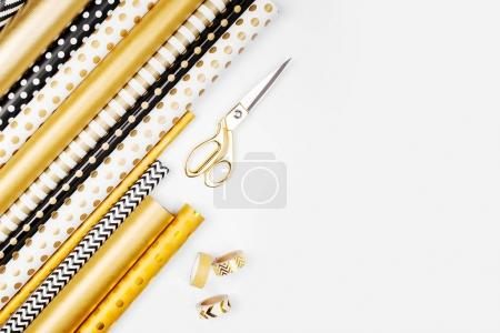 Christmas collection of wrapping paper in gold and black colors on white background