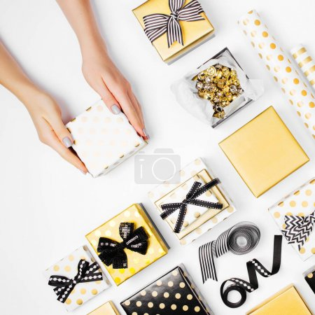 Female hands holding beautiful gift box, Christmas holidays and greeting season concept