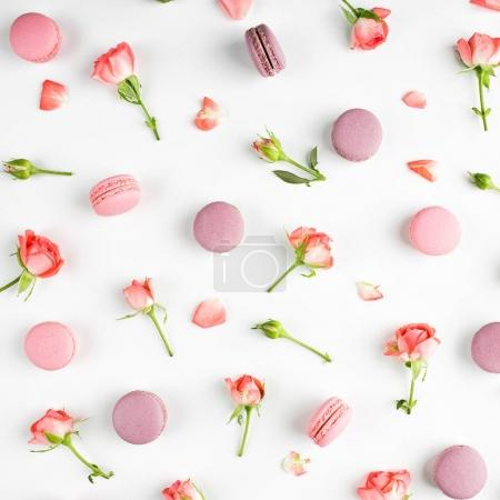 tender pattern with sweet macaroons and pink roses on white background