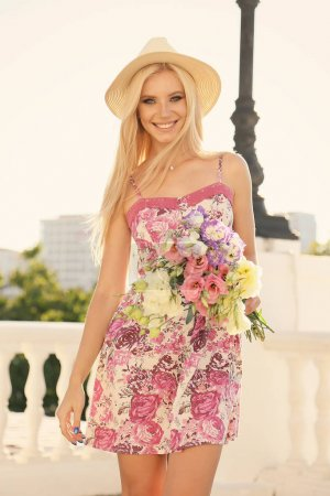 Photo for Fashion outdoor photo of beautiful girl with blond hair in elegant hat - Royalty Free Image