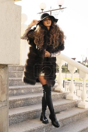 Photo for Fashion outdoor photo of beautiful sexy woman with dark hair in elegant clothes walking by city - Royalty Free Image