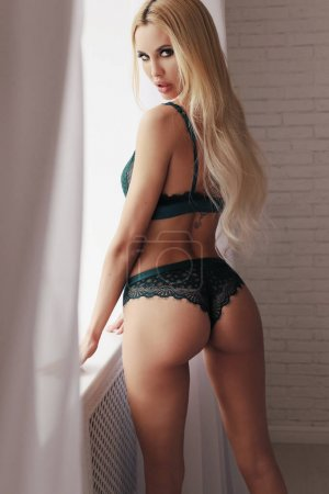 beautiful sexy woman with long blond hair in elegant lingerie