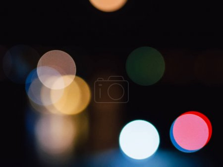 Photo for Round colorful blurred bokeh on dark background from bright lights of the night city - Royalty Free Image