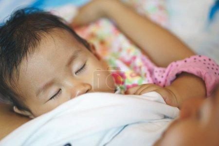 Breastfeeding 11 months Asian baby