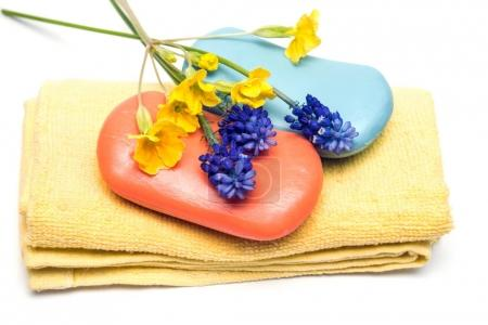 Towel, flowers and soap
