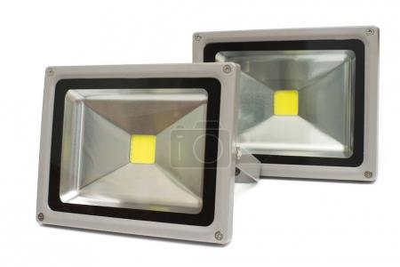 Two led projector isolated on white background. Street economica