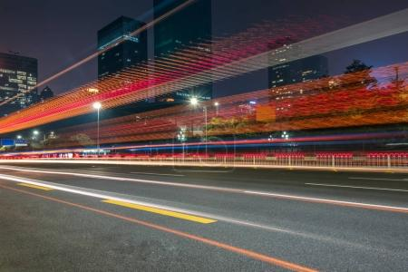 Photo for Urban traffic with cityscape at night in city of China. - Royalty Free Image