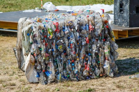 Photo for Ukraine Kiev MAY 10, 2019.Plastic bottles pressed and packed for recycling. recycling To conserve the environment concept.plastic bottles are collected to be melted into new plastic items. - Royalty Free Image