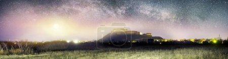 Castle in Mukachevo under the stars