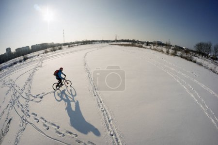 Man riding on bike in the snow