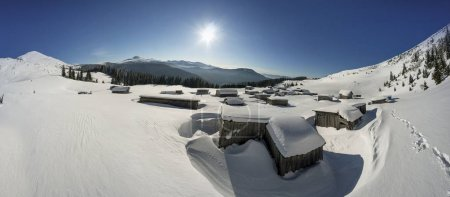 Snow-covered houses in the Carpathians