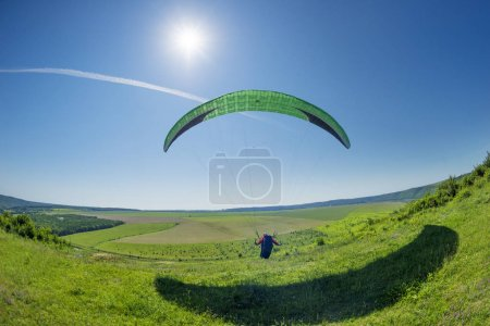 Air paragliding under the Sun
