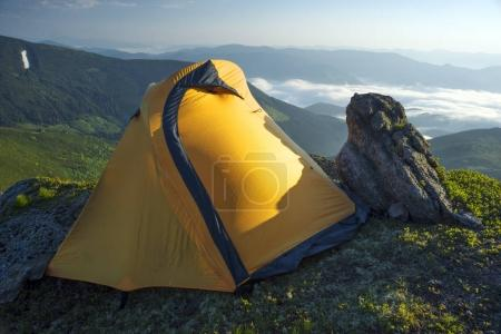 Tent in colorful mountains