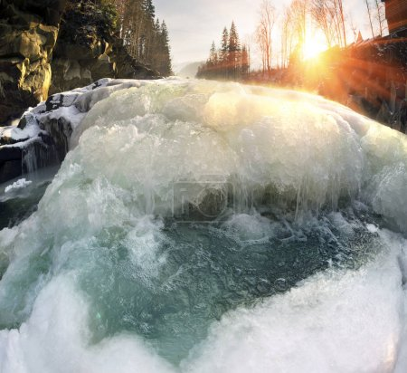 Waterfall on river at winter